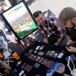 Folks playing Fire and Flora at IndieCade '15.